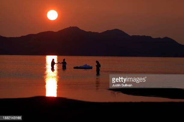 People wade in the waters of the Great Salt Lake on August 02, 2021 near Magna, Utah. As severe drought continues to take hold in the western United...