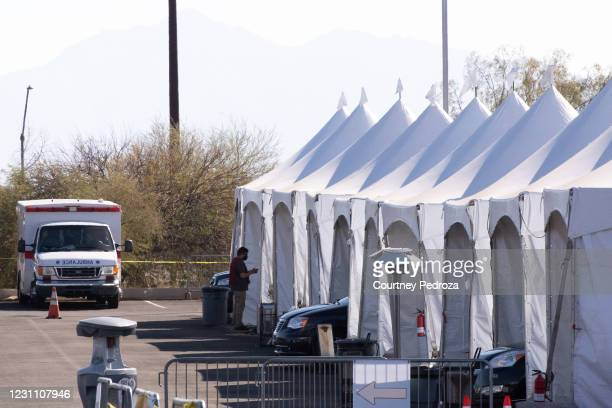 People wait after receiving the COVID-19 vaccination at State Farm Stadium on February 11, 2021 in Glendale, Arizona. Maricopa County is in phase 1B...