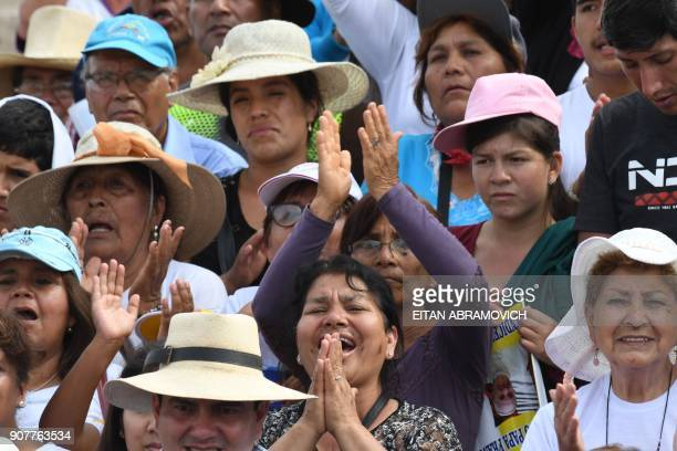 People wait along the streets of the Peruvian city of Trujillo to catch a glimpse of Pope Francis on January 20 2018 Pope Francis condemned...