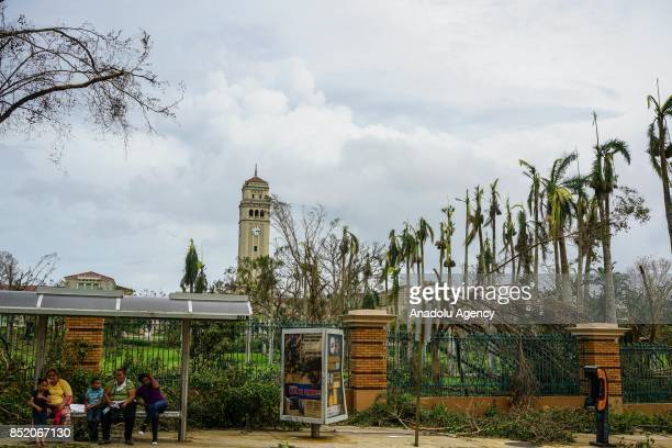 People wait at a bus stop at the University of Puerto Rico Rio Piedras campus after Hurricane Maria at Ponce de Leon Avenue in San Juan Puerto Rico...
