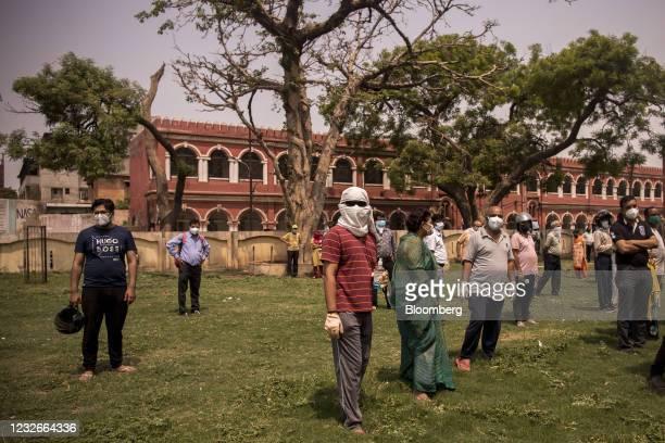 People wait at a Covid-19 vaccination center set up at the Sarojini Naidu Medical College in Agra, Uttar Pradesh, India, on Monday, May 3, 2021....