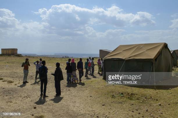 People wait at a registration centre on the Eritrean side of the EritreaEthiopia border ahead of crossing to Ethiopia on October 3 2018 The whirlwind...