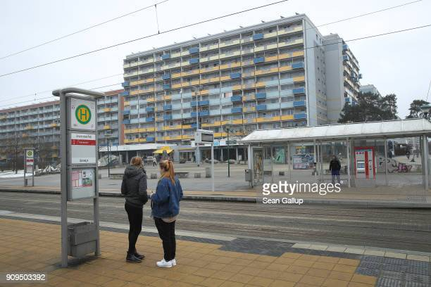 People wait at a tram stop in Sachsendorf district where many refugees from Syria and Afghanistan have settled on January 23 2018 in Cottbus Germany...