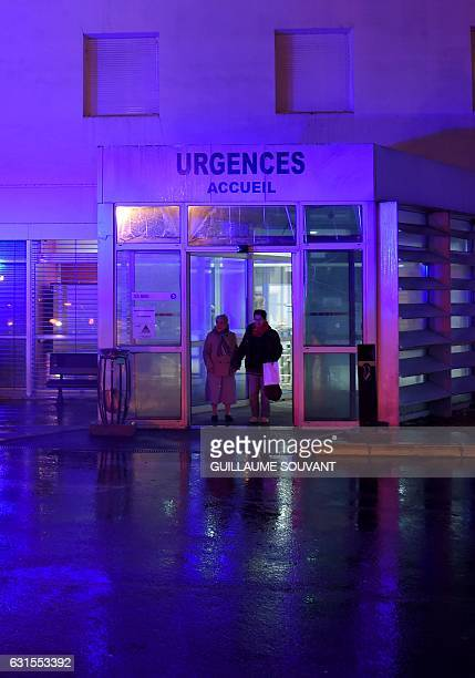 People wait at the entrance of the emergency department of the hospital of Trousseau in Tours on January 12 2017 French hospitals are being stretched...