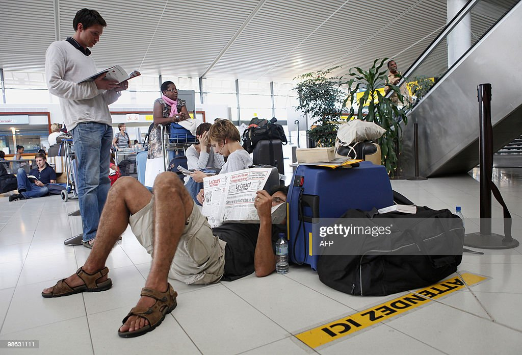 People wait at the Fort-de-France Aime Cesaire airport in Le Lamentin, on April 19, 2010 on the French island of Martinique. Air traffic remained seriously disrupted across Europe as a cloud of ash released from Iceland's volcanic eruption forced many countries to close their airspace. Most French airports including international hubs Charles de Gaulle and Orly will stay closed until on April 20.