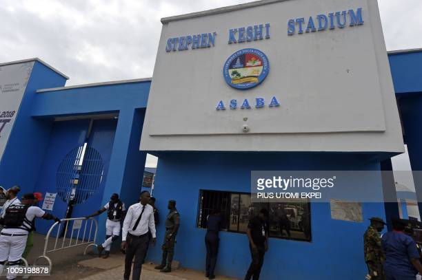 People wait at the main gate of the Stephen Keshi Stadium as they attend to the 21st African Senior Athletics Championships at the Stephen Keshi...