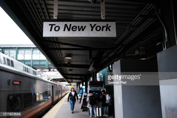 People wait at the New Rochelle train station on March 10 2020 in New Rochelle New York New Rochelle a city just north of New York City has become...
