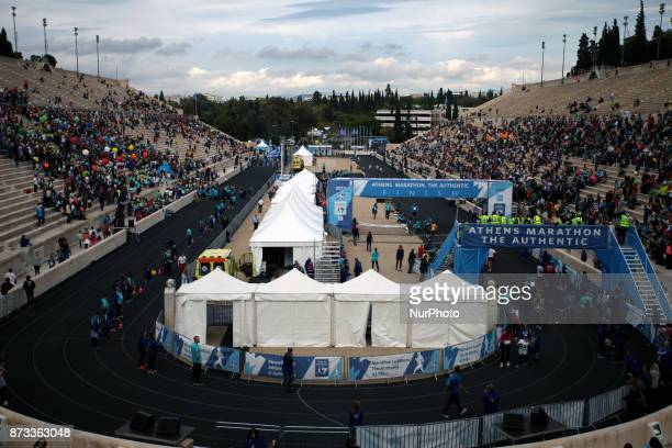 People wait at the Panathenaic stadium for the runners during the 35th Athens Classic Marathon in Athens Greece November 12 2017