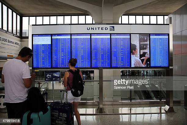 People wait at the United Airlines terminal at Newark Liberty Airport on July 8 2015 in Newark New Jersey A computer system glitch caused thousands...