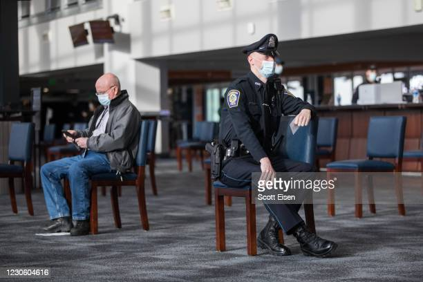 People wait for 15 minutes after receiving their COVID-19 vaccine at Gillette Stadium on January 15, 2021 in Foxborough, Massachusetts. First...