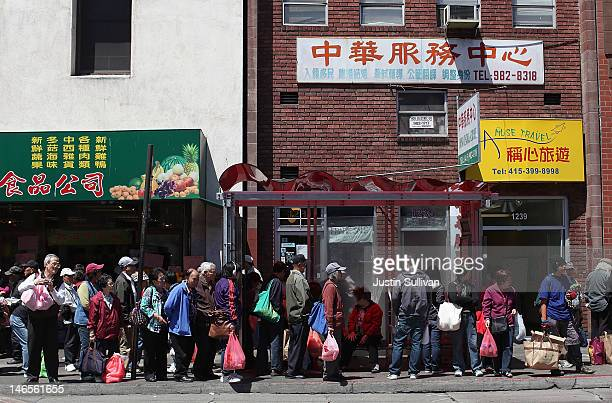 People wait for a bus in Chinatown on June 19 2012 in San Francisco California According to a study released today by the Pew Research Center Asians...