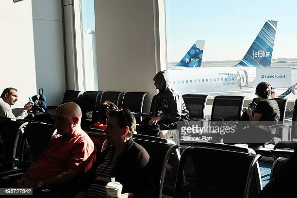 People wait for a flight at JFK Airport the day before Thanksgiving on November 25 2015 in New York City One of the biggest travel days of the year...