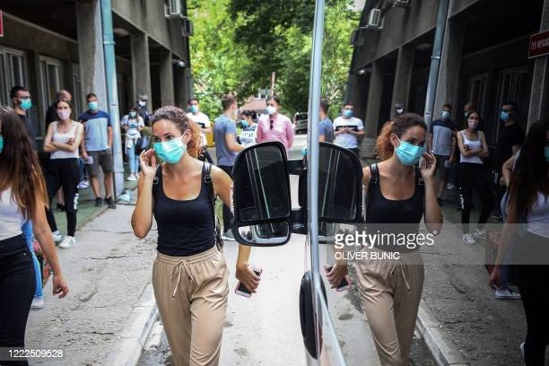 People wait for a medical examination outside the Clinic for Infectious and Tropical Diseases in Belgrade on June 24 as the number of coronavirus...