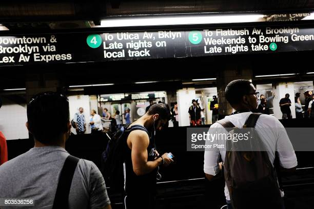 People wait for a Metropolitan Transportation Authority subway to arrive on June 29 2017 in New York City Following a series of breakdowns delays and...