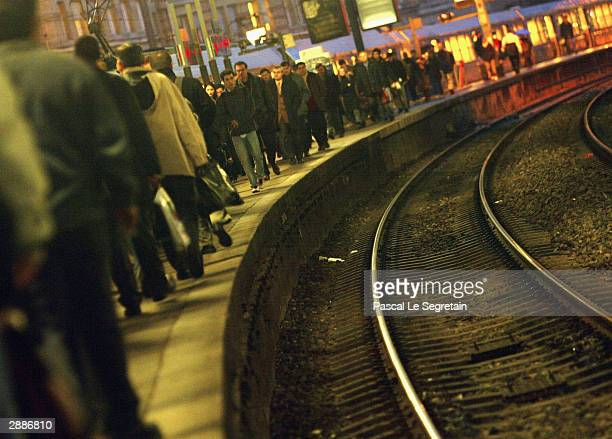People wait for a train on a platform at Saint Lazare railway station in central Paris as French rail workers stage a strike January 21 2004 in...