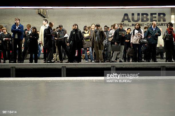 People wait for a train on a platform on March 23 2010 at the Auber suburban train station in Paris as French public sector workers including...