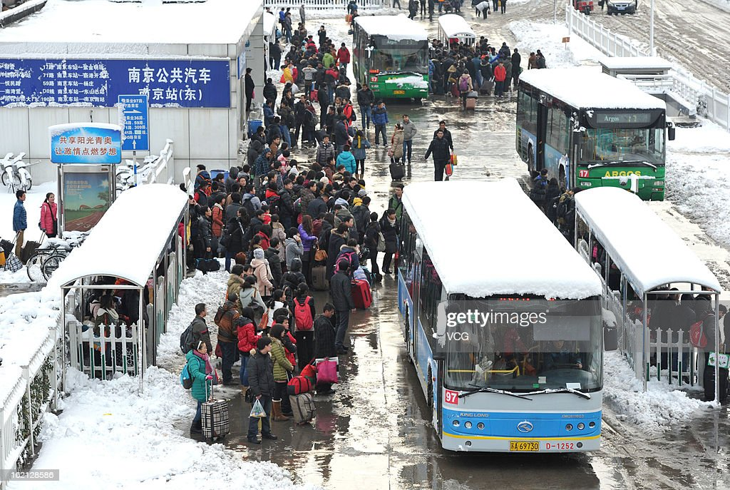 People wait for bus at a bus station after snowfall on February 19, 2013 in Nanjing, China. Heavy snow hit large areas of east China on Tuesday.