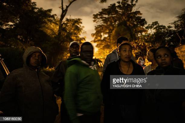 People wait for family members to be evacuated from the DusitD2 compound in Nairobi after a blast followed by a gun battle rocked the upmarket hotel...