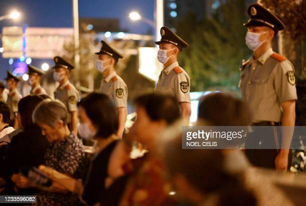 People wait for fireworks during a rehearsal of a performance marking the 100th anniversary of the founding of the Communist Party, at the Birds Nest...