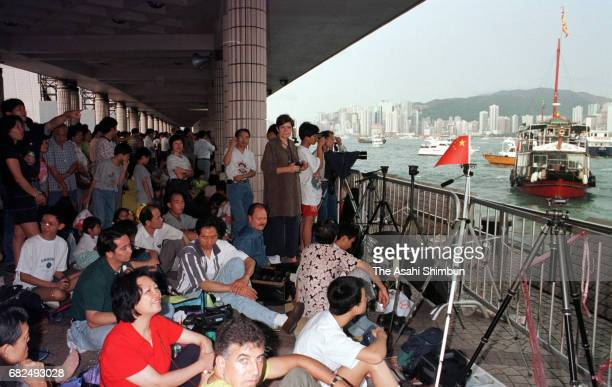 People wait for fireworks to celebrate the handover to China on June 30 1997 in Hong Kong