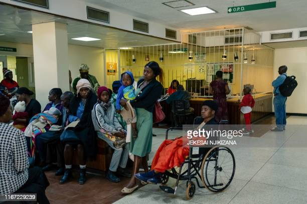 People wait for medical treatment at Parirenyatwa hospital in Harare September 9, 2019. - For Zimbabwe's doctors, few institutions reflect their...