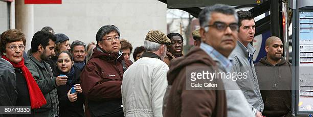 People wait for public transport at a bus-stop in Kingston Upon Thames town centre on April 19, 2008 in London, England. Tomorrow is the anniversary...