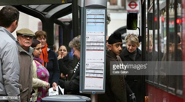 People wait for public transport at a busstop in Kingston Upon Thames town centre on April 19th 2008 in London England Tomorrow is the anniversary of...