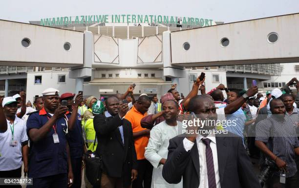 People wait for relatives at the Nnamdi Azikiwe International Airport in Abuja at the Nnamdi Azikiwe International Airport in Abuja on February 12...