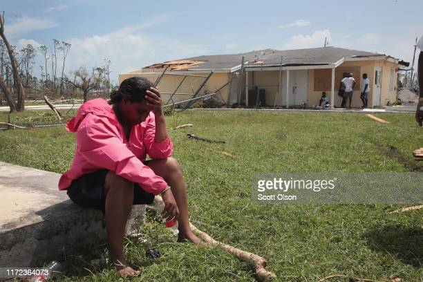 People wait for relief supplies to arrive at Treasure Cay Airport following Hurricane Dorian on September 4 2019 in Great Abaco Bahamas A massive...