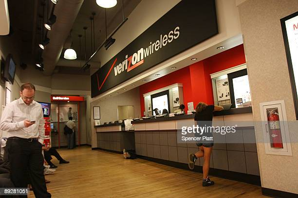 People wait for service inside a Verizon store July 27 2009 in New York City Verizon Communications Inc the secondlargest US telephone company posted...