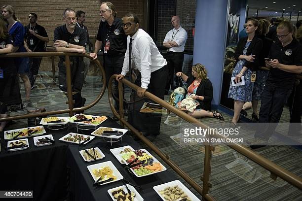 People wait for telemetry to be received from the New Horizons probe at the Johns Hopkins University Applied Physics Laboratory July 14 2015 in...