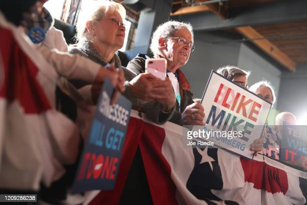 People wait for the arrival of Democratic presidential candidate former New York City mayor Mike Bloomberg during his campaign rally held at the...