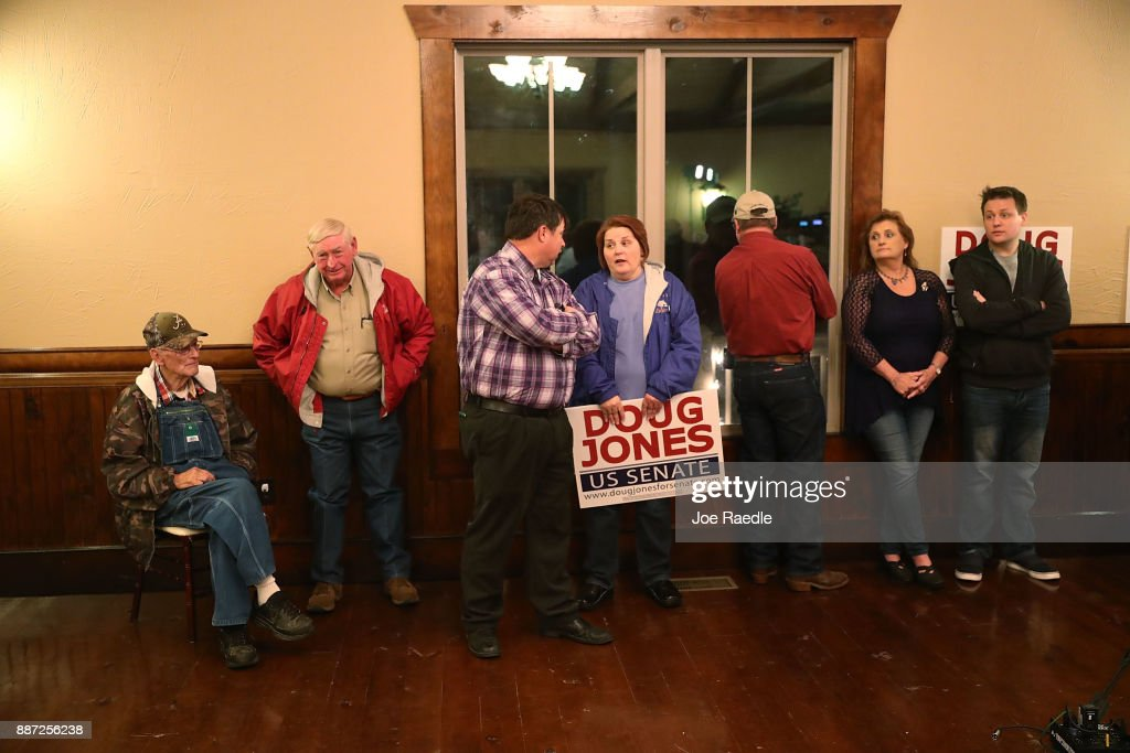 People wait for the arrival of Democratic Senatorial candidate Doug Jones for a 'Women's Wednesday' campaign event on December 6, 2017 in Cullman, Alabama. Mr. Jones is facing off against Republican Roy Moore in next week's special election for the U.S. Senate.
