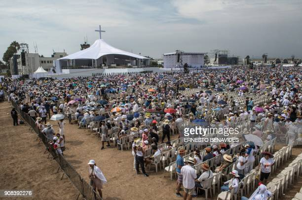 People wait for the arrival of Pope Francis at the Las Palmas air base in Lima where the pontiff will celebrate mass on January 21 2018 Pope Francis...