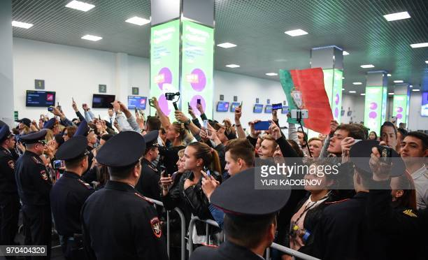 People wait for the arrival of Portugal's national football team players at the Zhukovsky airport about 40 kilometres southeast of Moscow city centre...