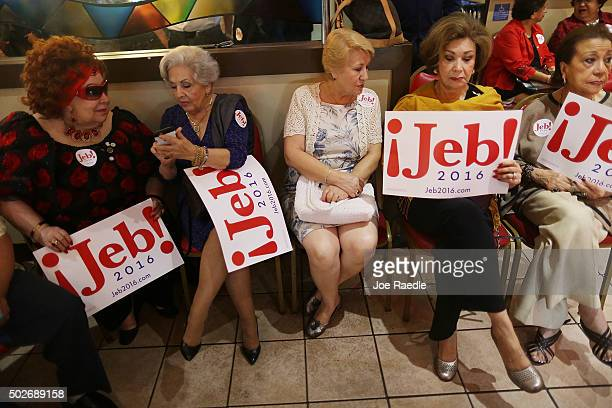 People wait for the arrival of Republican presidential candidate and former Florida Governor Jeb Bush for a meet and greet event at Chico's...