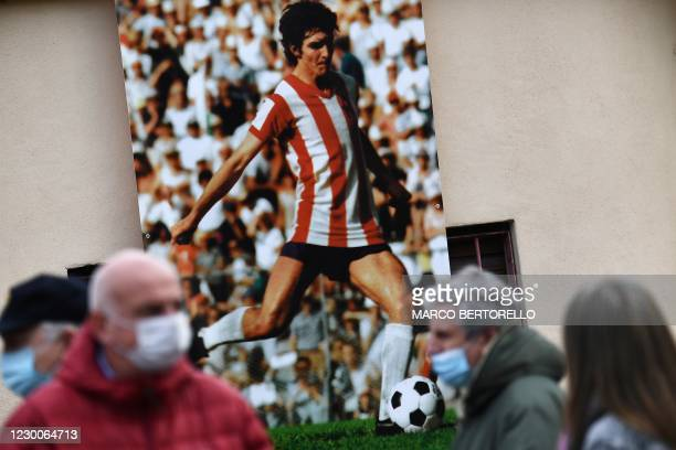 """People wait for the arrival of the coffin of former Italian football player Paolo Rossi out of the Romeo Menti"""" stadium in Vicenza, north-eastern..."""