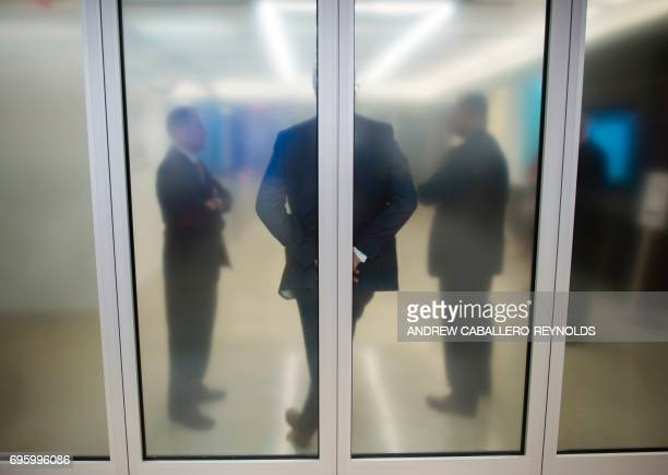 People wait for the arrival of US Federal Reserve Chair Janet Yellen for a press conference after the Federal Open Market Committee meeting in...