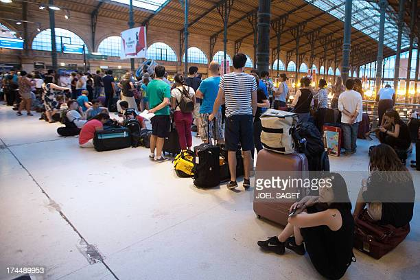 People wait for the Eurostar at the ParisNord railway station on July 26 after a French TGV and a Eurostar each carrying 500 passengers were blocked...