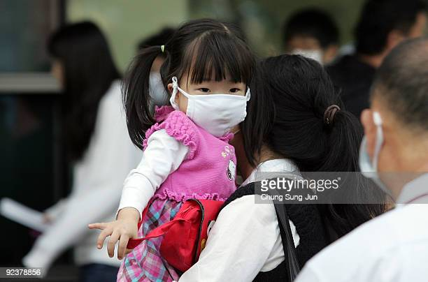 People wait for the H1N1 swine flu test at Korea University Hospital on October 27 2009 in Seoul South Korea The Korea Food and Drug Administration...