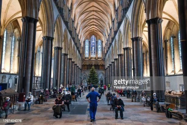 People wait for the Pfizer Covid vaccine at the vaccination centre set up inside Salisbury Cathedral on January 20, 2021 in Salisbury, England....