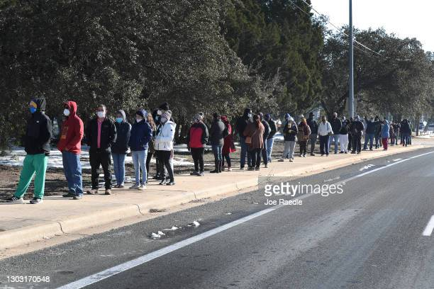 People wait for the Sam's Club store to open as they look to purchase essentials on February 20, 2021 in Austin, Texas. Winter storm Uri disrupted...