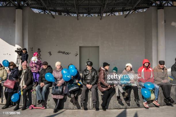 People wait for the start of a campaign rally with Ukrainian presidential candidate Yulia Tymoshenko on March 24 2019 in Kiev Ukraine Ukrainians are...
