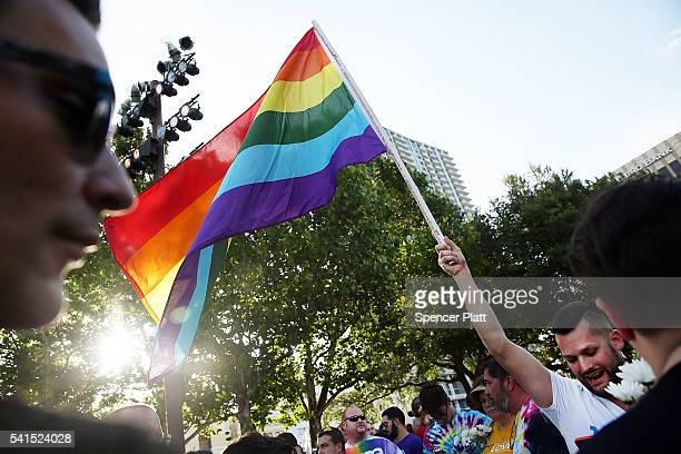 People wait for the start of a memorial service for the victims of the Pulse nightclub massacre on June 19 2016 in Orlando Florida Thousands of...