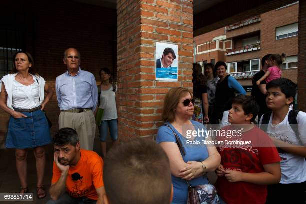 People wait for the start of a vigil in tribute to Ignacio Echavarria a victim of the London terror attack outside of Las Rozas City Council on June...
