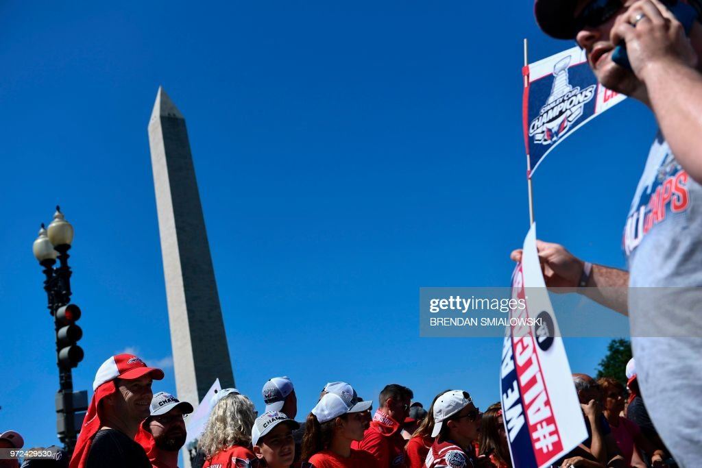 People wait for the start of the Washington Capitals Stanley Cup NHL hockey victory parade on June 12, 2018, in Washington,DC.