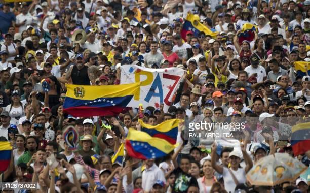 TOPSHOT People wait for the start of Venezuela Aid Live concert organized by British billionaire Richard Branson to raise money for the Venezuelan...