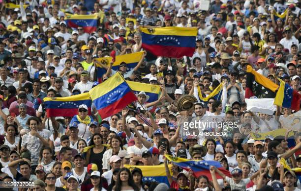 TOPSHOT People wait for the start of Venezuela Aid Live concert organized by British billionaire Richard Branson to raise money for the Venezuelan...