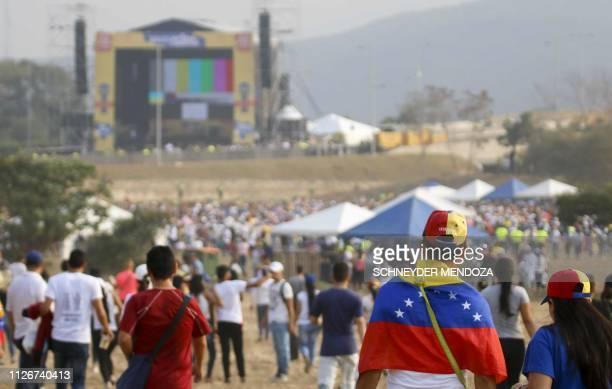 People wait for the start of Venezuela Aid Live concert organized by British billionaire Richard Branson to raise money for the Venezuelan relief...