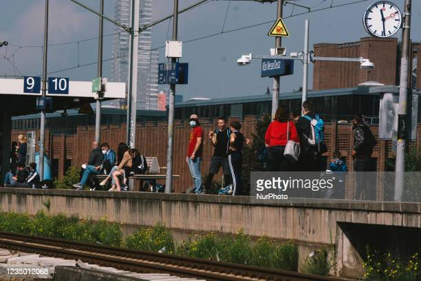 People wait for the train arrival on the platform of Deutz bahnhof in Cologne, Germany on September 2, 2021 as GDL train union calls for five days...